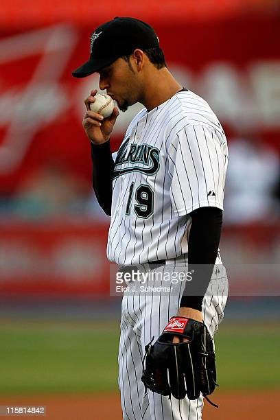 Anibal Sanchez of the Florida Marlins kisses the ball before delivering the first pitch against the Arizona Diamondbacks at Sun Life Stadium on June...