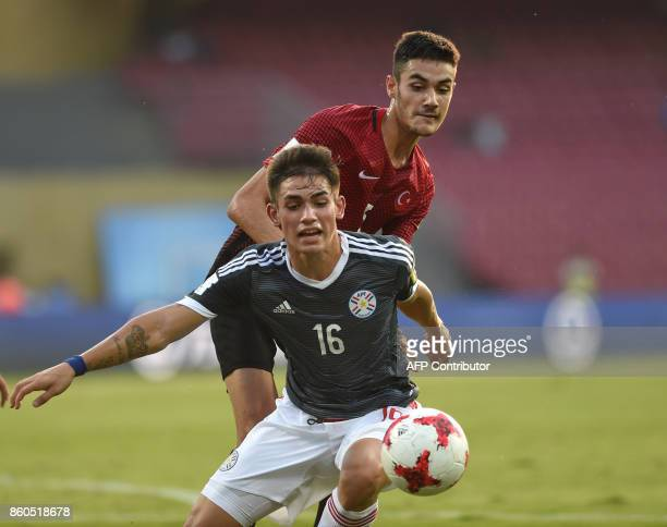 Anibal Vega of Paraguay and Ozan Kabak of Turkey vie for the ball during the group stage football match between Turkey and Paraguay in the FIFA U17...