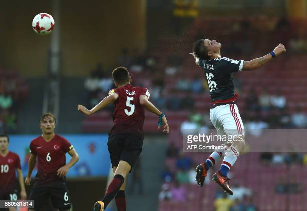 Anibal Vega of Paraguay vie for the ball during the group stage football match between Turkey and Paraguay in the FIFA U17 World Cup at the DYPatil...