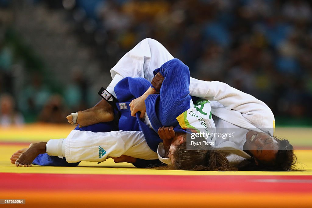 Anicka van Emden of the Netherlands and Kathrin Unterwurzacher of Austria compete during the Women's 63kg repechage contest bout on Day 4 of the Rio...