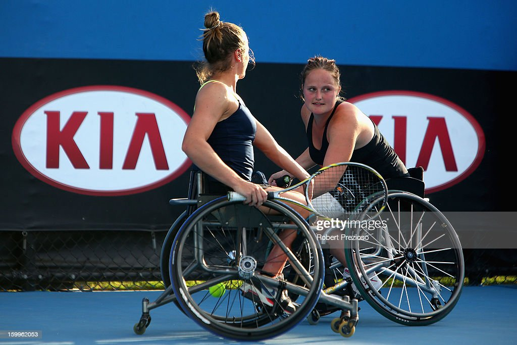 Aniek Van Koot and Jiske Griffioen of the Netherlands talk tactics in their Women's Wheelchair Doubles Semifinal match against Kgothatso Montjane of South Africa and Daniela Di Toro of Australia during the 2013 Australian Open Wheelchair Championships at Melbourne Park on January 24, 2013 in Melbourne, Australia.