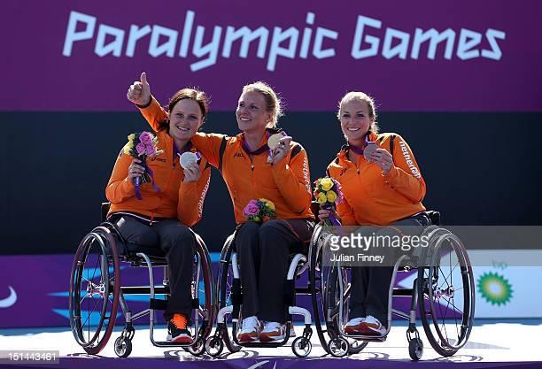 Aniek Van Koot of Netherlands with her silver medal Esther Vergeer of Netherlands with her gold medal and Jiske Griffioen of Netherlands with her...