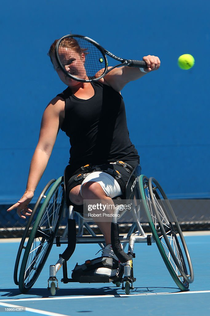 Aniek Van Koot of the Netherlands plays a backhand and Marjolein Buis of the Netherlands during the 2013 Australian Open Wheelchair Championships at Melbourne Park on January 24, 2013 in Melbourne, Australia.