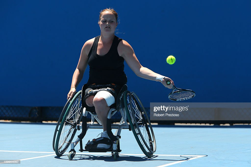 Aniek Van Koot of the Netherlands plays a forehand and Marjolein Buis of the Netherlands during the 2013 Australian Open Wheelchair Championships at Melbourne Park on January 24, 2013 in Melbourne, Australia.