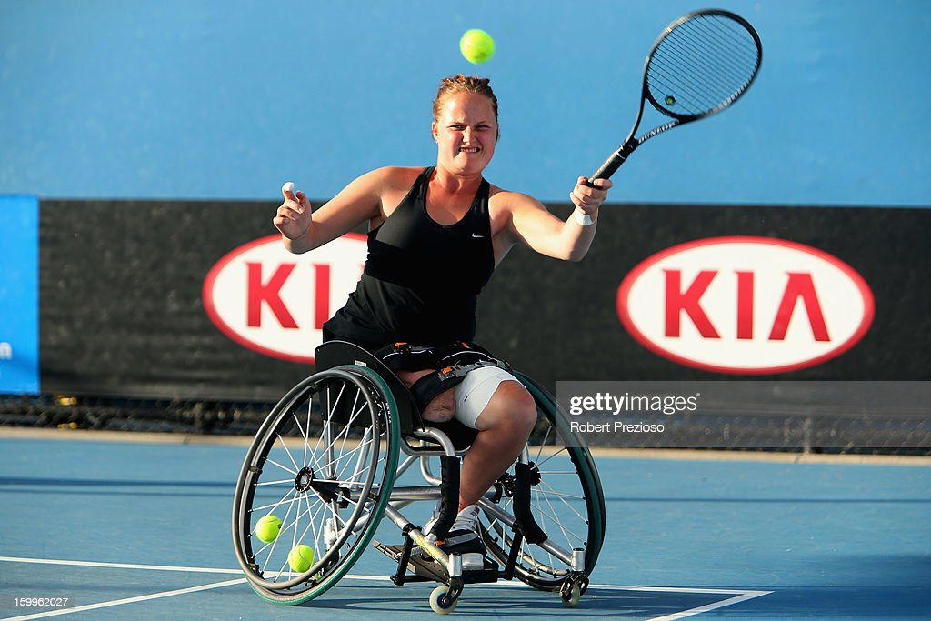 Aniek Van Koot of the Netherlands plays a forehand in her Women's Wheelchair Doubles Semifinal match with Jiske Griffioen of the Netherlands against Kgothatso Montjane of South Africa and Daniela Di Toro of Australia during the 2013 Australian Open Wheelchair Championships at Melbourne Park on January 24, 2013 in Melbourne, Australia.