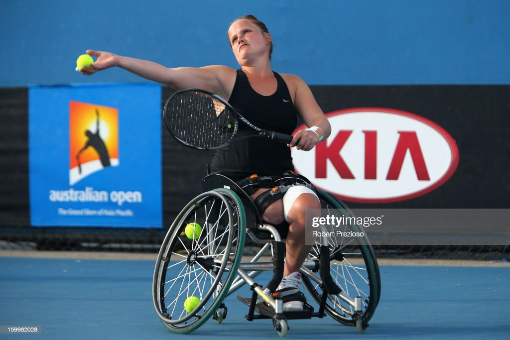 Aniek Van Koot of the Netherlands serves in her Women's Wheelchair Doubles Semifinal match with Jiske Griffioen of the Netherlands against Kgothatso Montjane of South Africa and Daniela Di Toro of Australia during the 2013 Australian Open Wheelchair Championships at Melbourne Park on January 24, 2013 in Melbourne, Australia.