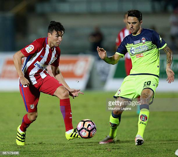 Aniello Salsano of Crotone competes for the ball with Nico Gaitan of Atletico de Madrid during presseason friendly match between FC Crotone and Club...