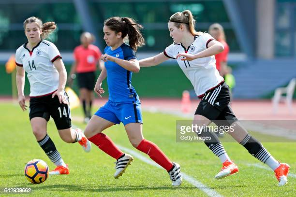 Anika Metzner and Laura Haas of Germany U16 Girls challenges Manon Revelli of France U16 Girls during the match between U16 Girls Germanyl v U16...