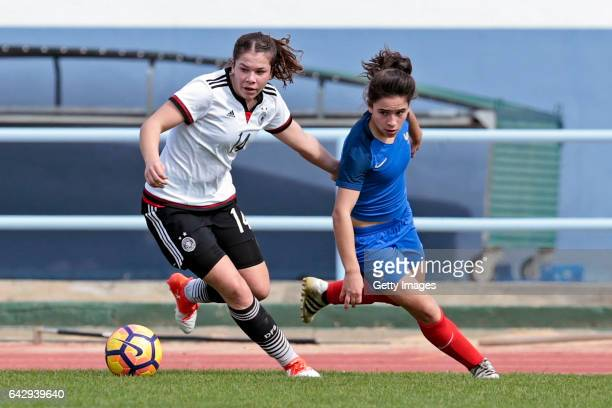 Anika Metzner of Germany U16 Girls challenges Adeline Coquard of France U16 Girls during the match between U16 Girls Germanyl v U16 Girls France on...
