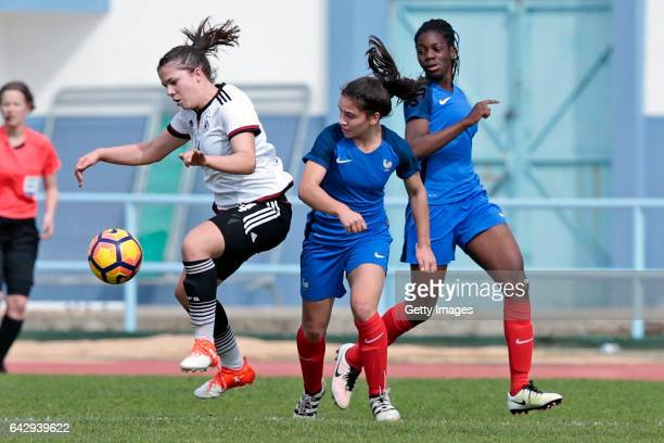 Anika Metzner of Germany U16 Girls challenges Manon Revelli and Naomie Feller of France U16 Girls during the match between U16 Girls Germanyl v U16...