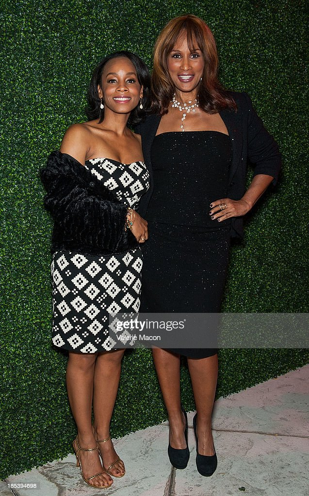 Anika Noni Rose and Beverly Johnson attends House of Flowers Dinner Honoring Diahann Carroll and Cheryl Boone Isaacs at Tracey Edmonds house on October 19, 2013 in Beverly Hills, California.