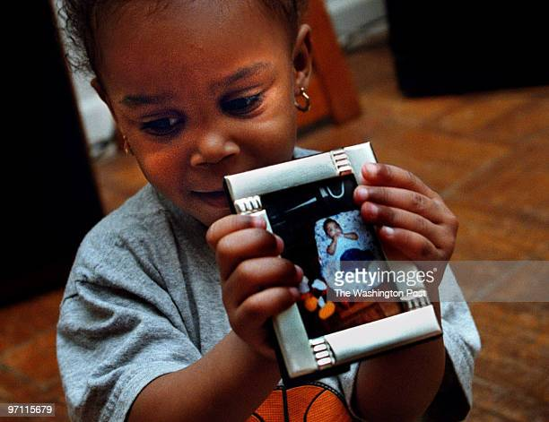 SARI Anika Perry holds a photo of her twin sister Tyrika a medically fragile infant who died in her playpen after the hospital put the twins into the...