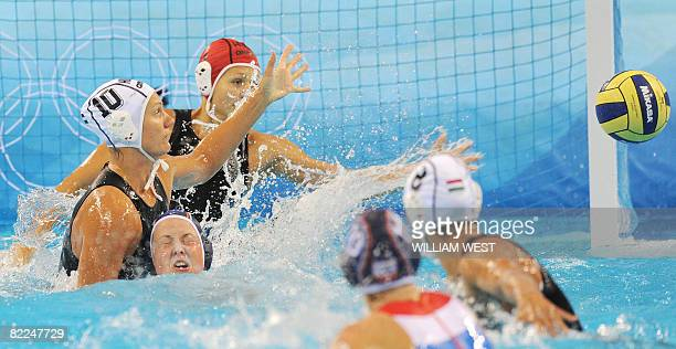 Aniko Pelle of Hungary pushes Lefke van Belkum of the Netherlands under the water during their 2008 Beijing Olympics Women's Water Polo match in...