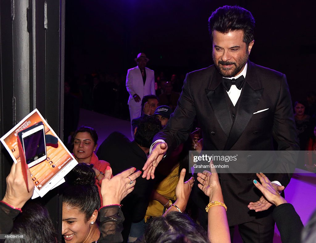<a gi-track='captionPersonalityLinkClicked' href=/galleries/search?phrase=Anil+Kapoor&family=editorial&specificpeople=563857 ng-click='$event.stopPropagation()'>Anil Kapoor</a> greets fans during the Indian Film Festival of Melbourne Awards Night at National Gallery of Victoria on August 15, 2015 in Melbourne, Australia.