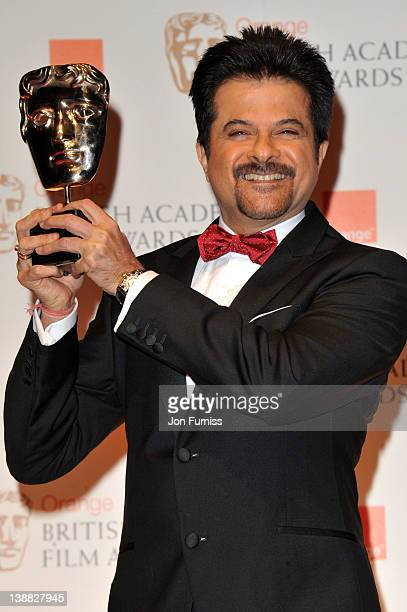 Anil Kapoor poses in the press room with the Film Not in The English Language award for 'The Skin I Live In' on behalf of Pedro Almodovar during the...