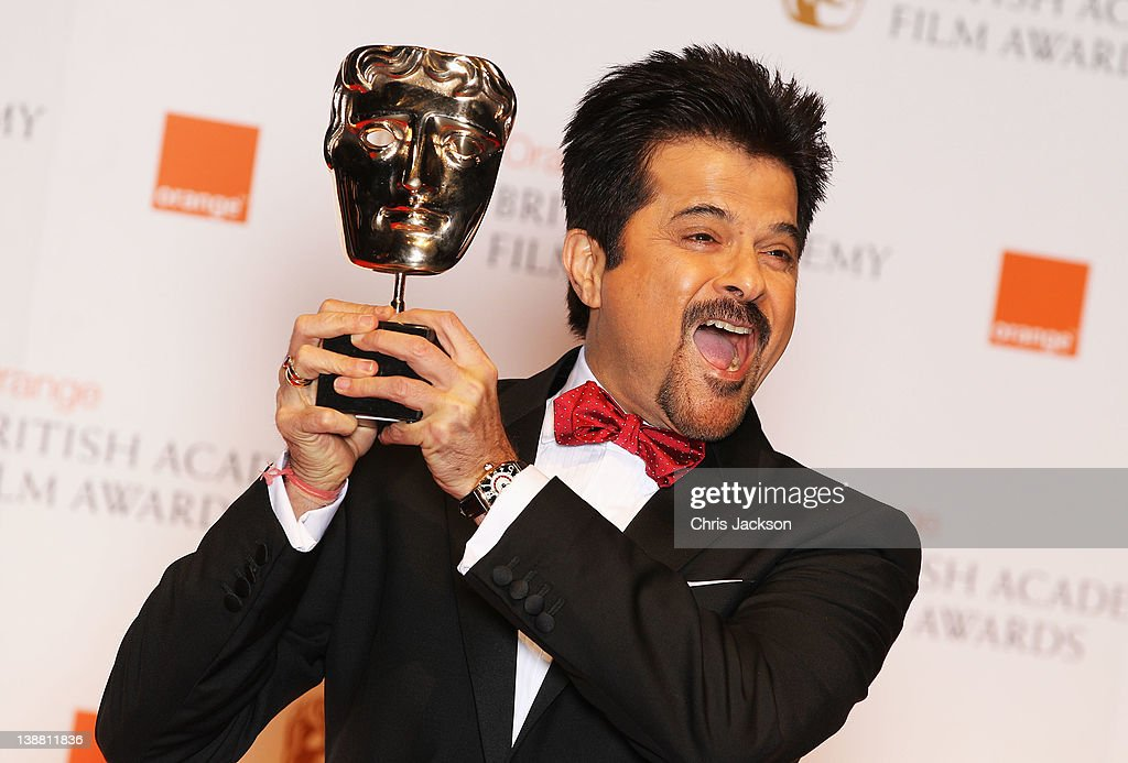 <a gi-track='captionPersonalityLinkClicked' href=/galleries/search?phrase=Anil+Kapoor&family=editorial&specificpeople=563857 ng-click='$event.stopPropagation()'>Anil Kapoor</a> poses with his Film Not In The English Language Award during the Orange British Academy Film Awards 2012 at the Royal Opera House on February 12, 2012 in London, England.