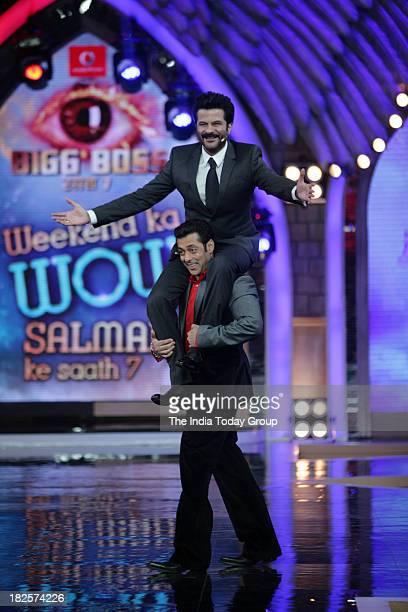 Anil Kapoor shakes a leg with Bigg Boss host Salman Khan on the sets of Bigg Boss in Mumbai