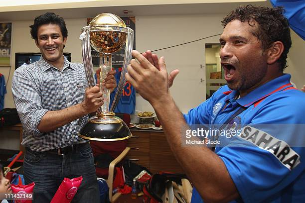 Anil Kumble ex Indian captain and Sachin Tendulkar hold the World Cup trophy after their six wicket win during the 2011 ICC World Cup Final between...