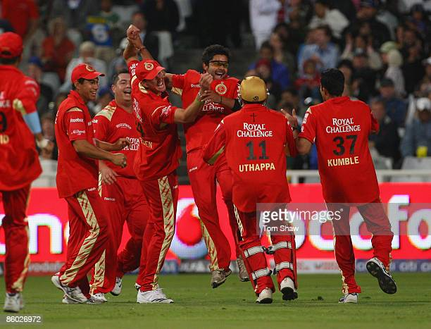 Anil Kumble of Bangalore celebrates with captain Kevin Pietersen after taking the wicket of Ravindra Jadeja of Rajasthan during the IPL T20 match...