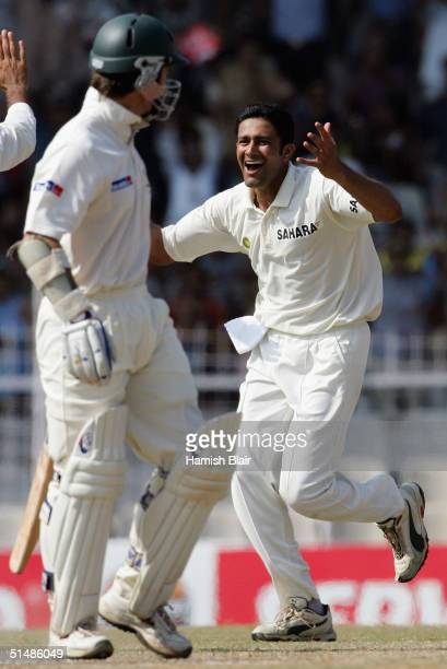 Anil Kumble of India celebrates the wicket of Justin Langer of Australia during day three of the Second Test between India and Australia played at MA...