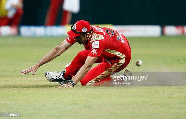 Anil Kumble of the Royal Challengers Bangalore lands on his left knee during the Airtel Champions League Twenty20 match between Mumbai Indians and...