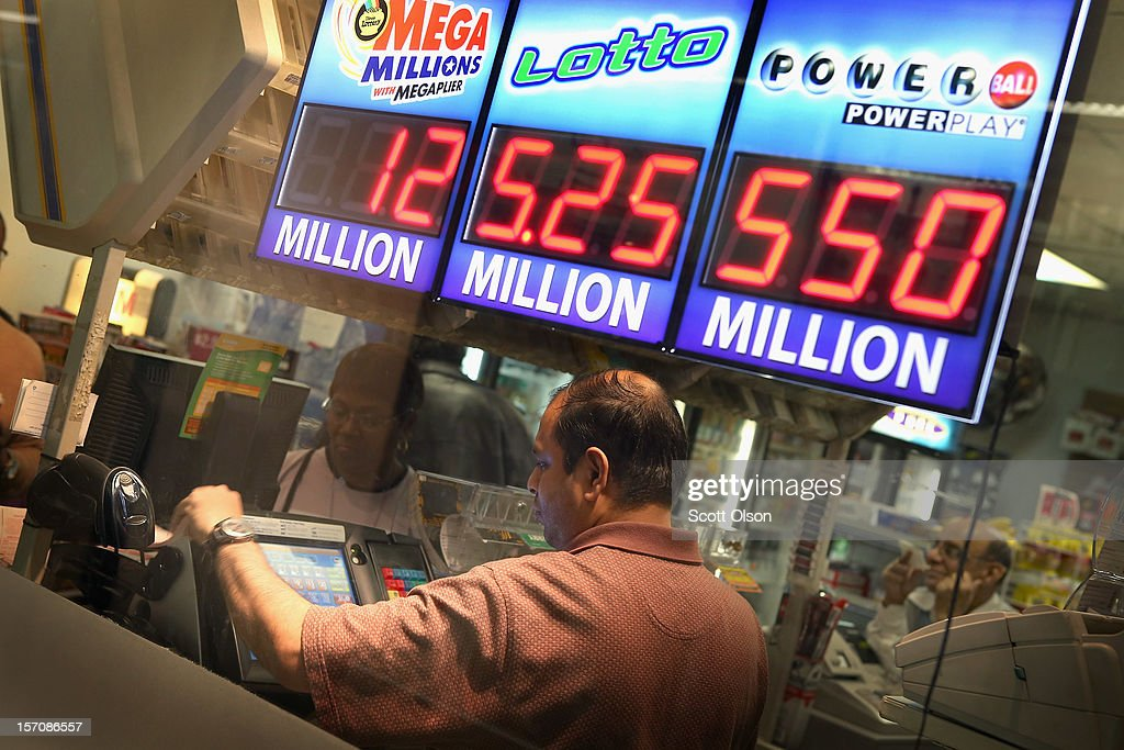 Anil P prints Powerball lottery tickets for customers at a convenience store on November 28, 2012 in Chicago, Illinois. The jackpot for Wednesday's Powerball drawing is currently at $550 million which is the richest Powerball pot ever. It is likely to rise even more as people continue to buy before tonights drawing.