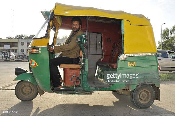 Anil Tomar an auto driver with his auto rickshaw who started his own free ambulance service for pregnant women on August 9 2014 in Indore India