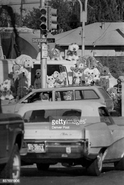 Animal Flair This herd of stuffed toy animals peers out over a herd of humans and their cars during rushhour traffic at West 5th Avenue and Sheridan...