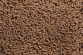 Animal food pellets. Background texture.