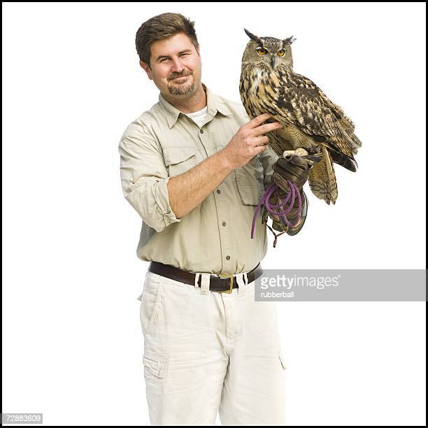Animal handler with owl