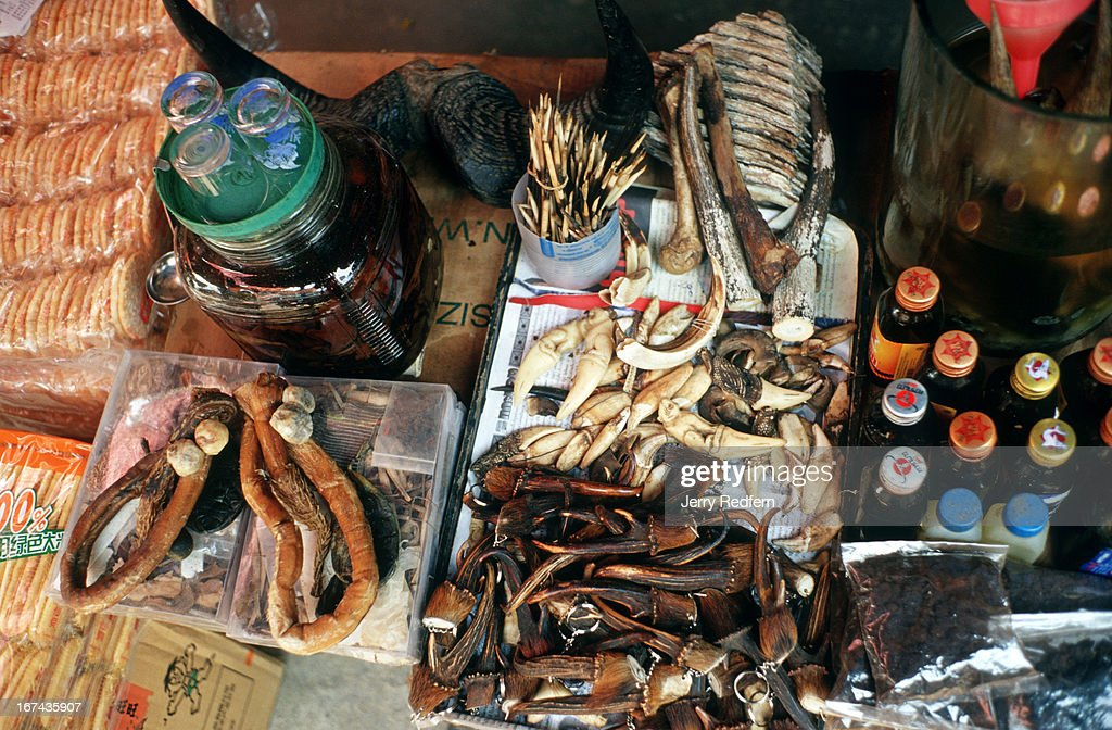 Animal parts - including elephant teeth, deer horns, gaur antlers, tiger teeth, tiger penis, porcupine quills and bear gall - are sold at a market just over the border from the Thai town of Mae Sai..