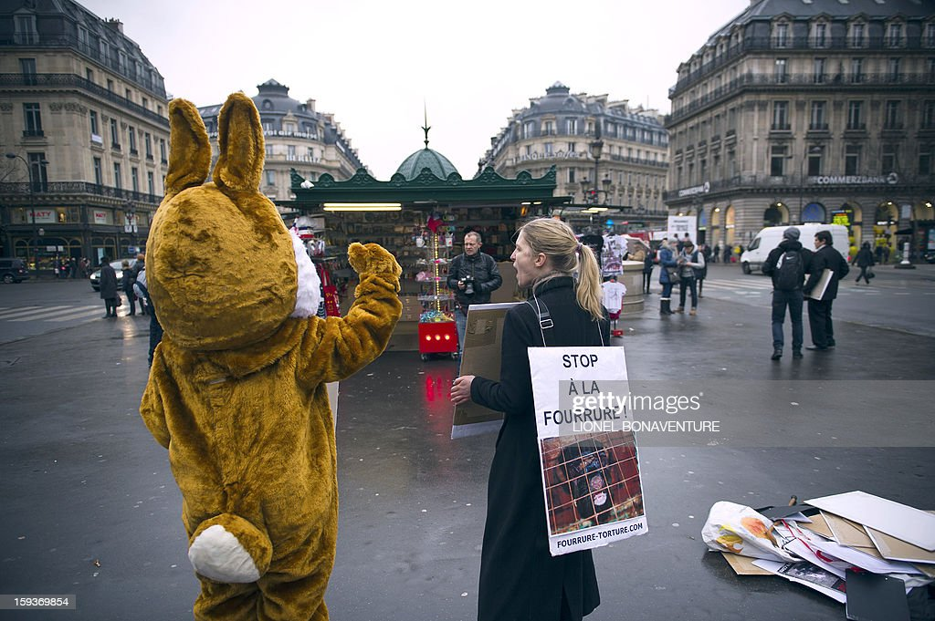 Animal rights activists demonstrate on January 12, 2013 in front of the Opera in Paris, to protest against cruelty towards animals and the use of fur in the fashion industry, during a nationwide anti-fur demonstration called by French association 'Fourrure Torture' (Fur Torture).