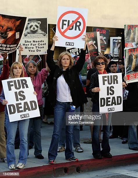 Animal rights groups and PETA stop in front of a Prada store on Rodeo Drive during an antifur demonstration urging Black Friday shoppers to stop...