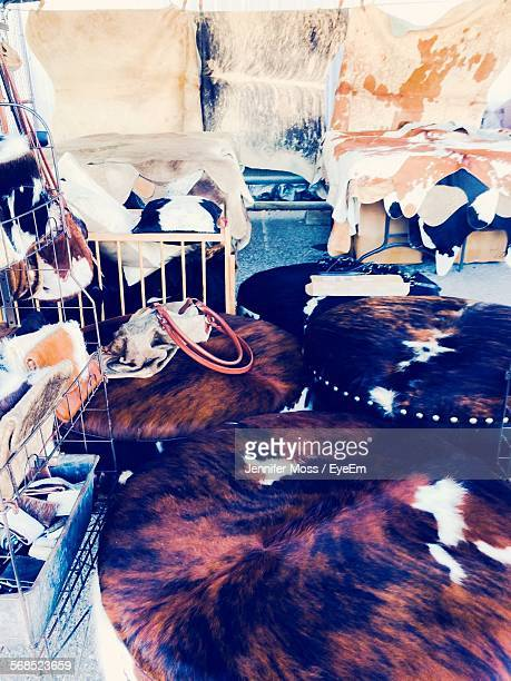 Animal Skin Rugs With Purses And Ottomans In Store For Sale