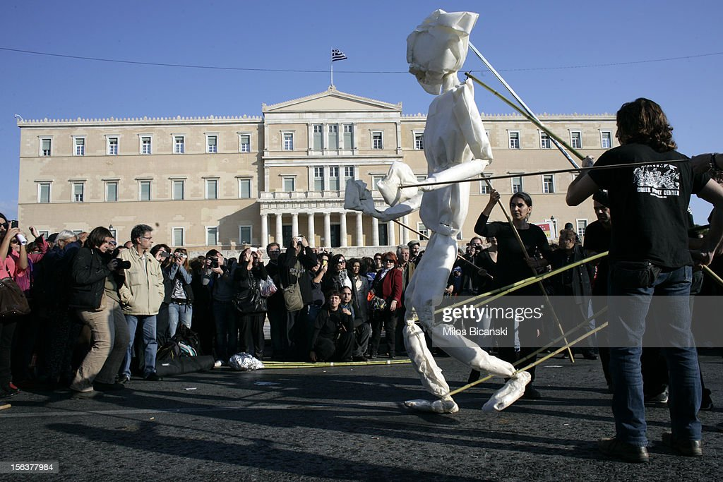 Animateurs from a Greek puppet center stage a performance outside the Greek parliament during an anti-austerity protest on November 14, 2012 in Athens, Greece. Unions in Spain, Portugal and Greece went on strike in what has become the first broad-based anti-austerity action to protest government plans amid a wide economic scope across Europe.