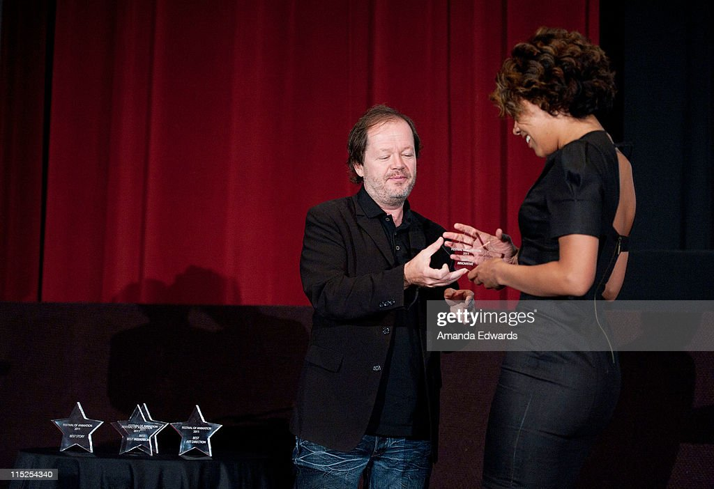Animation director Chuck Sheetz (L) presents an award to Vivian Lee at the UCLA Animation Workshop Festival of Animation at the James Bridges Theater at Melnitz Hall on the UCLA campus on June 4, 2011 in Los Angeles, California.