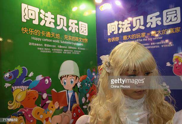 A animation lover views cartoon figure toys at the Second China International Software Product Expo on September 1 2006 in Nanjing of Jiangsu...