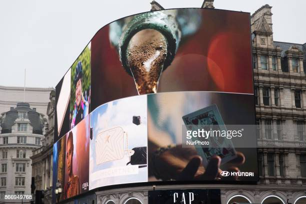 Animations are seen after the countdown as the Piccadilly Circus lights are switched back on after a nine month renovation on October 26 2017 in...