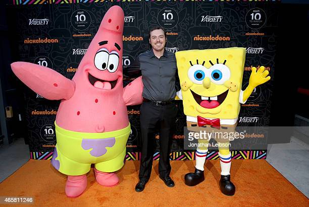 Animator Animator Phil Bourassa poses with television characters Patrick Star and SpongeBob SquarePants attend the Variety and Nickelodeon 10...