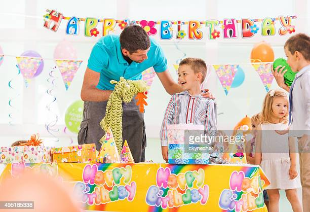 Animator entertaining little boy at birthday party.