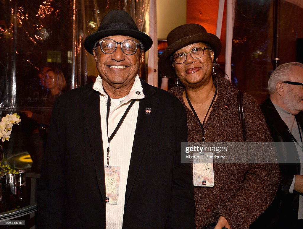 Animator Floyd Norman (L) and Adrienne Norman attend the 90 Years of Disney Animation celebration at Walt Disney Studios on December 10, 2013 in Burbank, California.