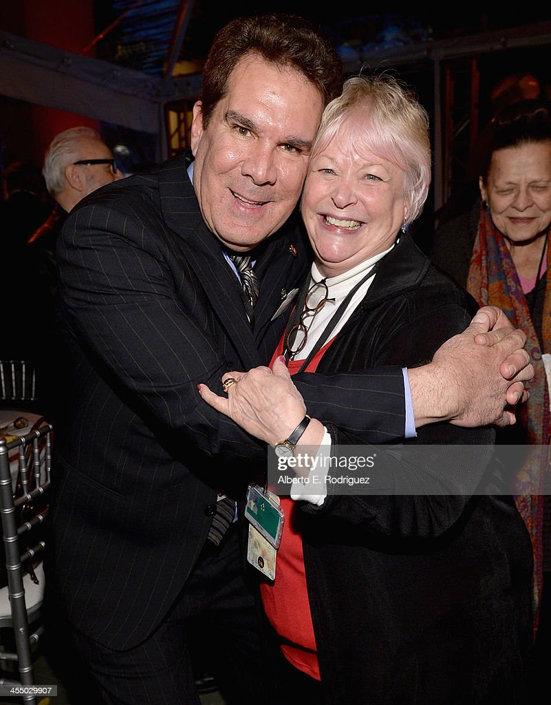 Animator Tony Anselmo (L) and voice actress Russi Taylor attend the 90 Years of Disney Animation celebration at Walt Disney Studios on December 10, 2013 in Burbank, California.