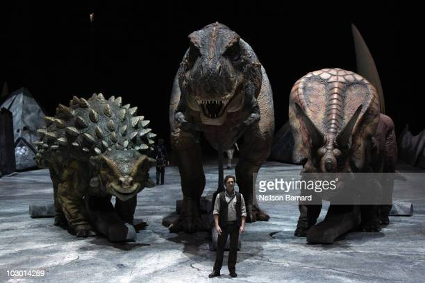 Animatronic dinosaurs are on display along with Jared Van Heel who plays the part of the Paleontologist before the opening day of 'Walking With...