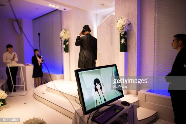 Anime fan marry his VR anime girl crush and exchange wedding vows in front of an altar of a chapel in Tokyo Japan on June 30 2017 A marketing event...