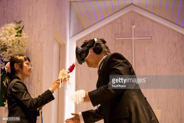 Anime fan prepares to kiss his new wife a lips made of marshmallow in front of an altar of a chapel in Tokyo Japan on June 30 2017 A marketing event...