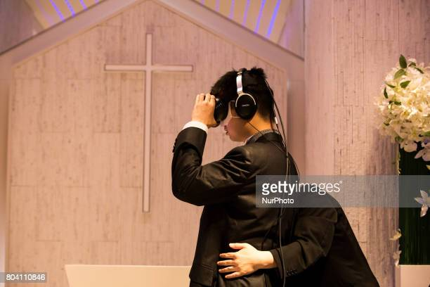 Anime fan prepares to marry his VR anime girl crush in front of an altar of a chapel in Tokyo Japan on June 30 2017 A marketing event by Japanese...