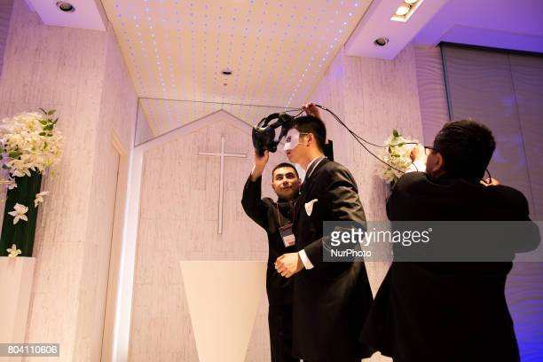 Anime fan prepares to wear VR headset to marry his VR anime girl crush in front of an altar of a chapel in Tokyo Japan on June 30 2017 A marketing...