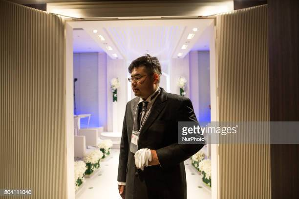 Anime fan walks out of a chapel after his wedding ceremony in Tokyo Japan on June 30 2017 A marketing event by Japanese video game maker Hibiki Works...