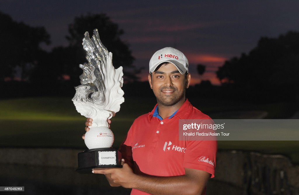 Anirban Lahiri celebrates with the trophy after winning of the CIMB Niaga Indonesian Masters at Royale Jakarta Golf Club on April 27, 2014 in Jakarta, Indonesia.