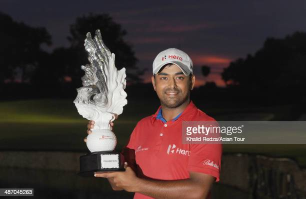 Anirban Lahiri celebrates with the trophy after winning of the CIMB Niaga Indonesian Masters at Royale Jakarta Golf Club on April 27 2014 in Jakarta...